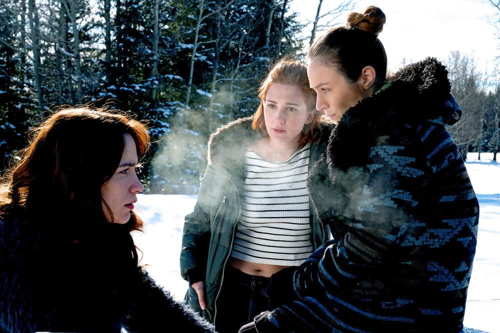 """WYNONNA EARP -- """"Everybody Knows"""" Episode 207 -- Pictured: (l-r) Melanie Scrofano as Wynonna Earp, Katherine Barrell as Officer Nicole Haught, Dominique Provost-Chalkley as Waverly Earp"""