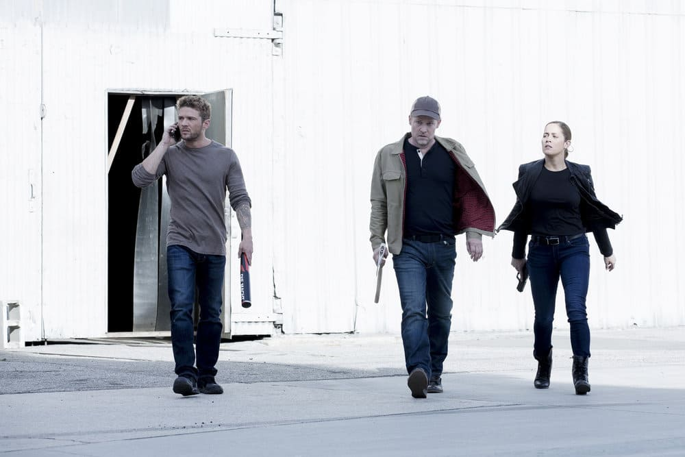 "SHOOTER -- ""Remember the Alamo"" Episode 202 -- Pictured: (l-r) Ryan Phillippe as Bob Lee Swagger, Todd Lowe as Colin Hobbs, Jaina Lee Ortiz as Angela Tio"