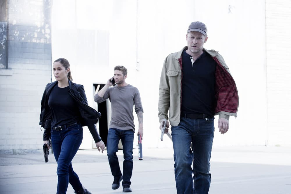 "SHOOTER -- ""Remember the Alamo"" Episode 202 -- Pictured: (l-r) Jaina Lee Ortiz as Angela Tio, Ryan Phillippe as Bob Lee Swagger, Todd Lowe as Colin Hobbs"