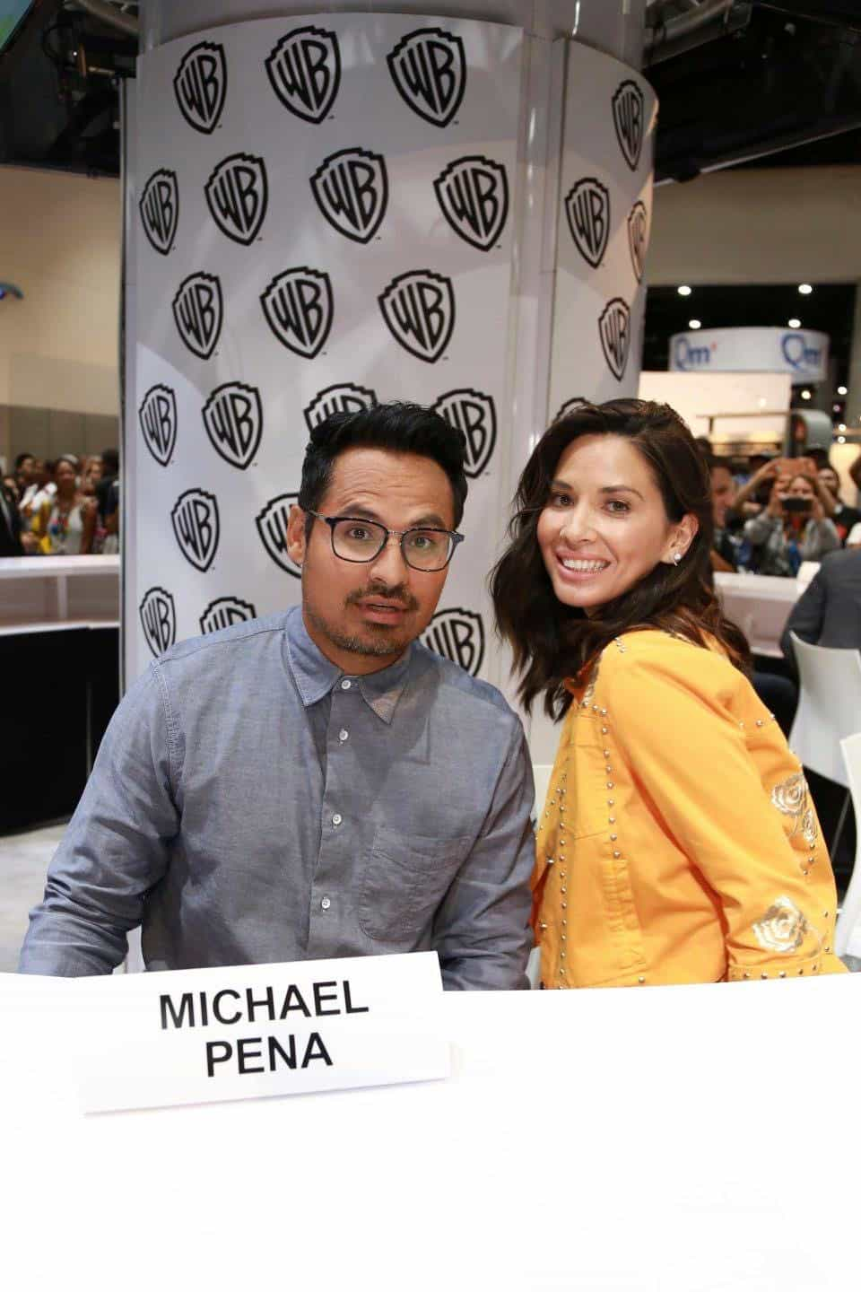 HE LEGO NINJAGO MOVIE stars Michael Peña and Olivia Munn get ready to greet fans at the Warner Bros. booth at Comic-Con 2017 on Thursday, July 20. #WBSDCC (© 2017 WBEI. All Rights Reserved)