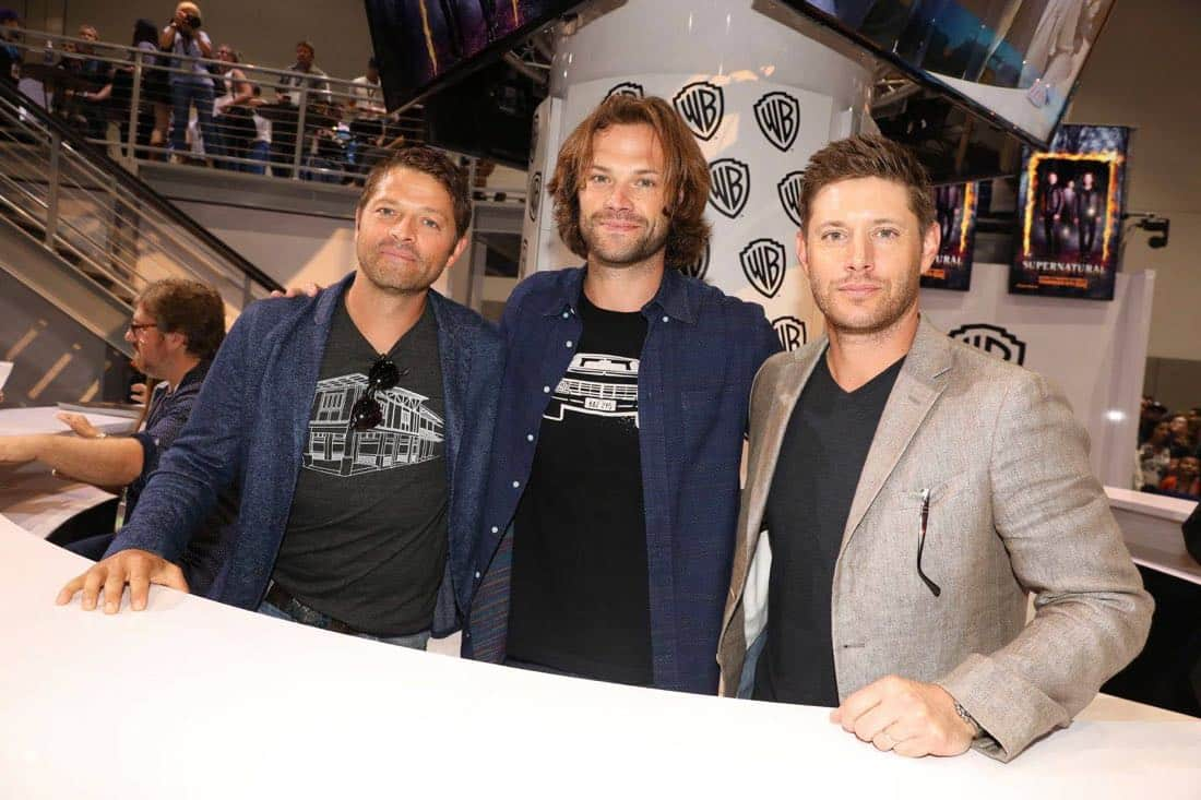SUPERNATURAL stars Misha Collins (left), Jared Padalecki, and Jensen Ackles (right) stop by the Warner Bros. booth at Comic-Con 2017 on Sunday, July 23. #WBSDCC (© 2017 WBEI. All Rights Reserved)