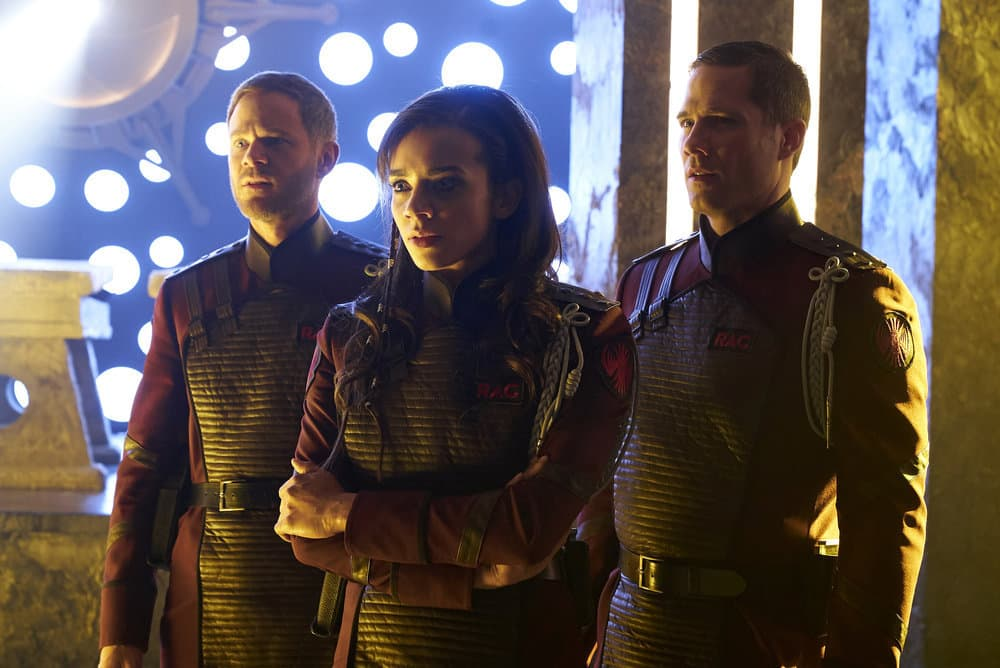 "KILLJOYS -- ""Necropolis Now"" Episode 306 -- Pictured: (l-r) Aaron Ashmore as John, Hannah John-Kamen as Dutch, Luke Macfarlane as D'Avin -- (Photo by: Steve Wilkie/Killjoys III Productions Limited/Syfy)"