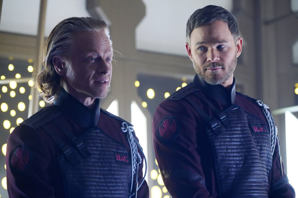 "KILLJOYS -- ""Necropolis Now"" Episode 306 -- Pictured: (l-r) Patrick Garrow as Turin, Aaron Ashmore as John -- (Photo by: Steve Wilkie/Killjoys III Productions Limited/Syfy)"