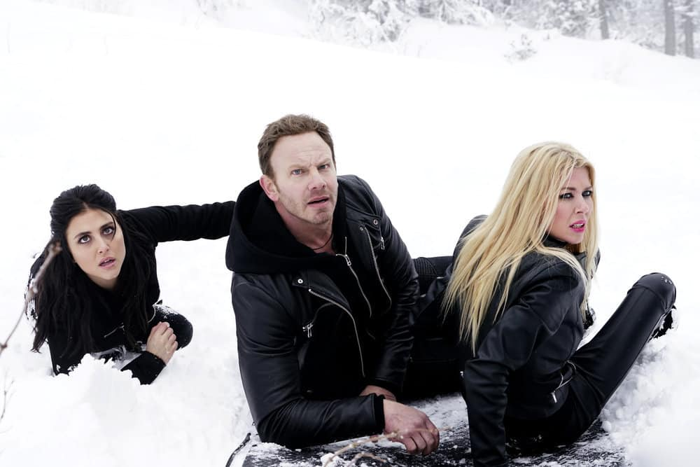 SHARKNADO 5: GLOBAL SWARMING -- Pictured: (l-r) Cassie Scerbo as Nova Clarke, Ian Ziering as Fin Shepard, Tara Reid as April Shepard -- (Photo by: Yana Blajeva/Syfy)