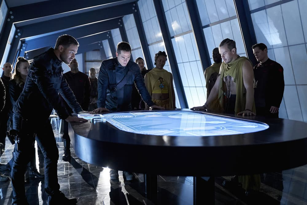 "KILLJOYS -- ""The Wolf You Feed"" Episode 307 -- Pictured: (l-r) Aaron Ashmore as John, Luke Macfarlane as D'Avin, Morgan Kelly as Alvis -- (Photo by: Steve Wilkie/Killjoys III Productions Limited/Syfy)"