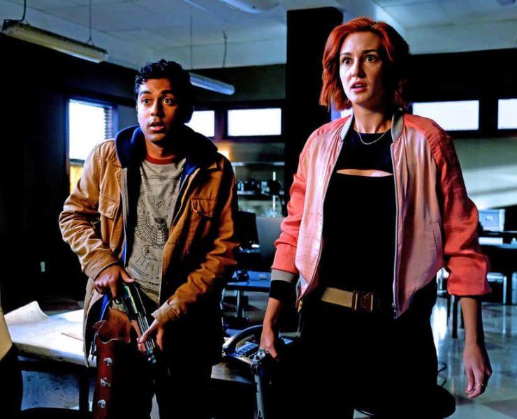 "WYNONNA EARP -- ""I Hope You Dance"" Episode 212 -- Pictured: (l-r) Varun Saranga as Jeremy, Katherine Barrell as Officer Nicole Haught -- (Photo by: Michelle Faye/Syfy/Wynonna Earp Season 2)"