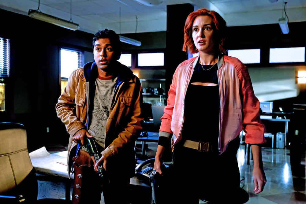 "WYNONNA EARP -- ""I Hope You Dance"" Episode 212 -- Pictured: (l-r) Varun Saranga as Jeremy, Katherine Barrell as Officer Nicole Haught -- (Photo by: Michelle Faye/Syfy/Wynonna Earp Season 2)"
