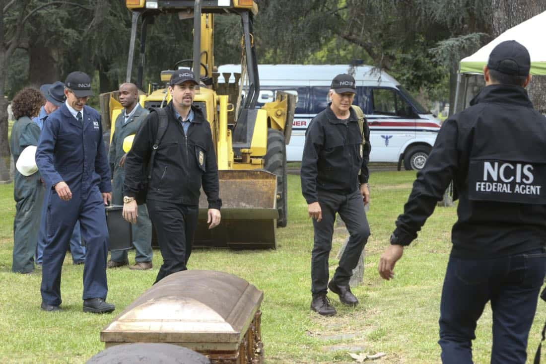 """""""Twofer"""" -- NCIS is called in to investigate when the body of a missing Navy Lieutenant who disappeared a year and a half ago is located by a cemetery grounds crew while they are relocating caskets on the property. Also, Gibbs and McGee must pass a psych evaluation with Doctor Grace Confalone (Laura San Giacomo) before officially resuming all work responsibilities, on NCIS, Tuesday, Oct. 3 (8:00-9:00 PM, ET/PT) on the CBS Television Network. Pictured: Brian Dietzen, Sean Murray, Mark Harmon, Wilmer Valderramma.    Photo: Patrick McElhenney/CBS ©2017 CBS Broadcasting, Inc. All Rights Reserved"""