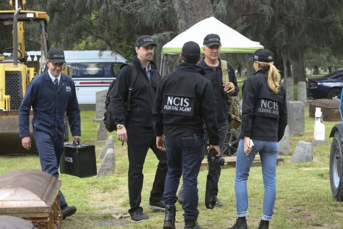 """""""Twofer"""" -- NCIS is called in to investigate when the body of a missing Navy Lieutenant who disappeared a year and a half ago is located by a cemetery grounds crew while they are relocating caskets on the property. Also, Gibbs and McGee must pass a psych evaluation with Doctor Grace Confalone (Laura San Giacomo) before officially resuming all work responsibilities, on NCIS, Tuesday, Oct. 3 (8:00-9:00 PM, ET/PT) on the CBS Television Network. Pictured: Brian Dietzen, Sean Murray, Mark Harmon, Wilmer Valderramma, Emily Wickersham.    Photo: Patrick McElhenney/CBS ©2017 CBS Broadcasting, Inc. All Rights Reserved"""