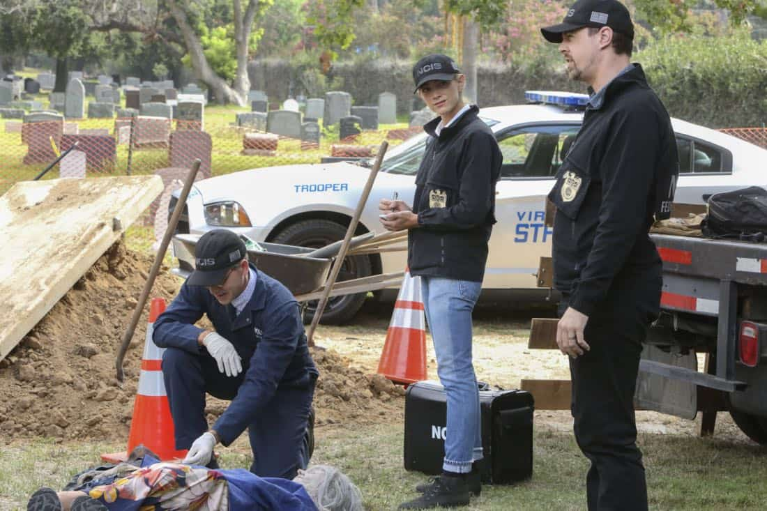 """""""Twofer"""" -- NCIS is called in to investigate when the body of a missing Navy Lieutenant who disappeared a year and a half ago is located by a cemetery grounds crew while they are relocating caskets on the property. Also, Gibbs and McGee must pass a psych evaluation with Doctor Grace Confalone (Laura San Giacomo) before officially resuming all work responsibilities, on NCIS, Tuesday, Oct. 3 (8:00-9:00 PM, ET/PT) on the CBS Television Network. Pictured: Brian Dietzen,  Emily Wickersham, Sean Murray.    Photo: Patrick McElhenney/CBS ©2017 CBS Broadcasting, Inc. All Rights Reserved"""
