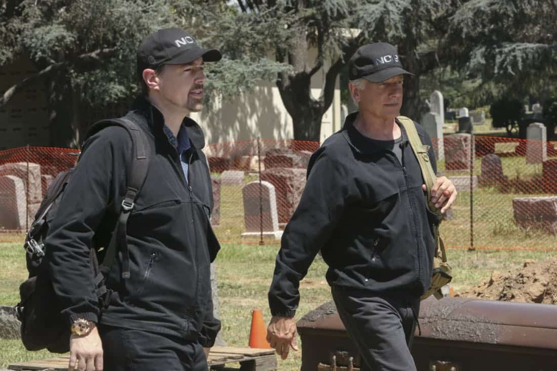 """""""Twofer"""" -- NCIS is called in to investigate when the body of a missing Navy Lieutenant who disappeared a year and a half ago is located by a cemetery grounds crew while they are relocating caskets on the property. Also, Gibbs and McGee must pass a psych evaluation with Doctor Grace Confalone (Laura San Giacomo) before officially resuming all work responsibilities, on NCIS, Tuesday, Oct. 3 (8:00-9:00 PM, ET/PT) on the CBS Television Network. Pictured: Sean Murray, Mark Harmon.   Photo: Patrick McElhenney/CBS ©2017 CBS Broadcasting, Inc. All Rights Reserved"""