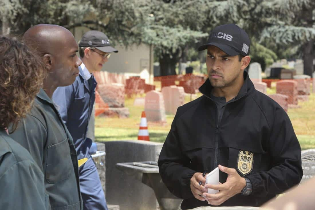 """""""Twofer"""" -- NCIS is called in to investigate when the body of a missing Navy Lieutenant who disappeared a year and a half ago is located by a cemetery grounds crew while they are relocating caskets on the property. Also, Gibbs and McGee must pass a psych evaluation with Doctor Grace Confalone (Laura San Giacomo) before officially resuming all work responsibilities, on NCIS, Tuesday, Oct. 3 (8:00-9:00 PM, ET/PT) on the CBS Television Network. Pictured: Brian Dietzen, Wilmer Valderramma.  Photo: Patrick McElhenney/CBS ©2017 CBS Broadcasting, Inc. All Rights Reserved"""