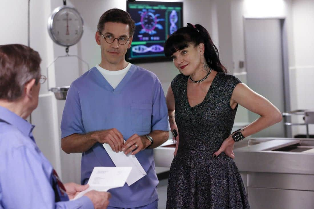 """""""Twofer"""" -- NCIS is called in to investigate when the body of a missing Navy Lieutenant who disappeared a year and a half ago is located by a cemetery grounds crew while they are relocating caskets on the property. Also, Gibbs and McGee must pass a psych evaluation with Doctor Grace Confalone (Laura San Giacomo) before officially resuming all work responsibilities, on NCIS, Tuesday, Oct. 3 (8:00-9:00 PM, ET/PT) on the CBS Television Network. Pictured:  David McCallum, Brian Dietzen, Pauley Perrette.  Photo: Robert Voets/CBS ©2017 CBS Broadcasting, Inc. All Rights Reserved"""