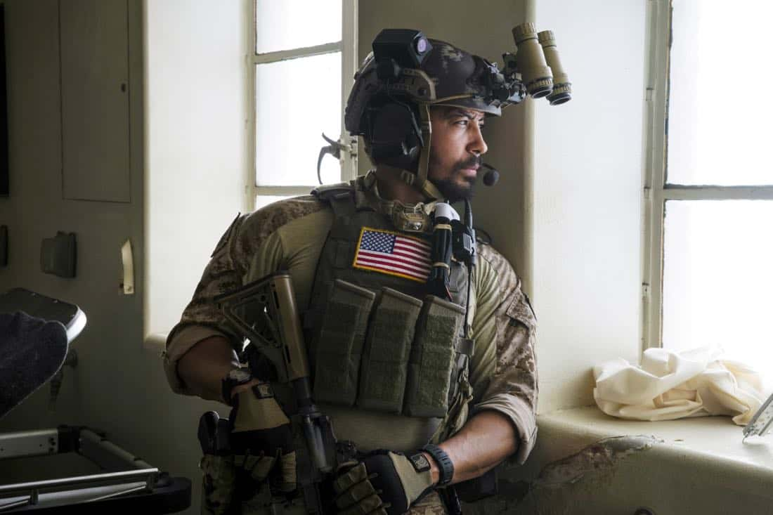 """Other Lives"" -- While on an evidence-collecting mission in Syria, Jason and the SEAL Team find innocent civilians in desperate need of rescue just as enemy forces close in on them. Also, while on the mission, the team debates whether or not to tell Ray that his wife has gone into labor, on SEAL TEAM, Wednesday, Oct. 4 (9:00-10:00 PM, ET/PT) on the CBS Television Network. Pictured: Neil brown Jr. as Ray.   Photo: Erik Voake/CBS©2017 CBS Broadcasting, Inc. All Rights Reserved"