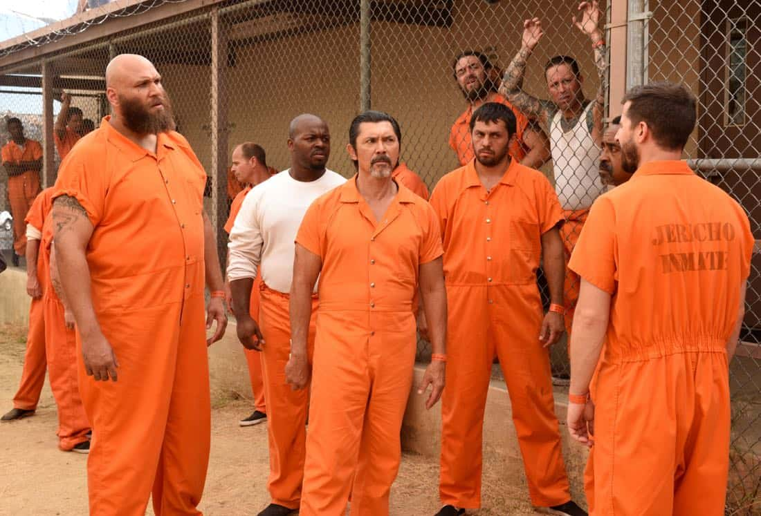 "BROOKLYN NINE-NINE: Guest star Winston James Francis (L), guest star Lou Diamond Phillips (C), guest star Tim Meadows (2nd R) and Andy Samberg (R) in the ""The Big House Pt.2"""