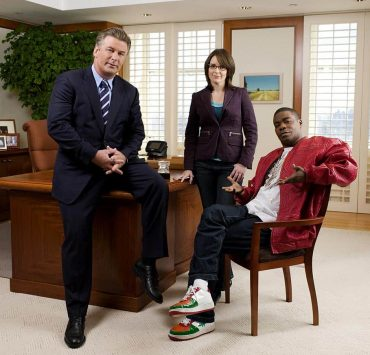 30 ROCK -- Pictured: (l-r) Alec Baldwin as Jack Donaghy, Tina Fey as Liz Lemon, Tracy Morgan as Tracy Jordan