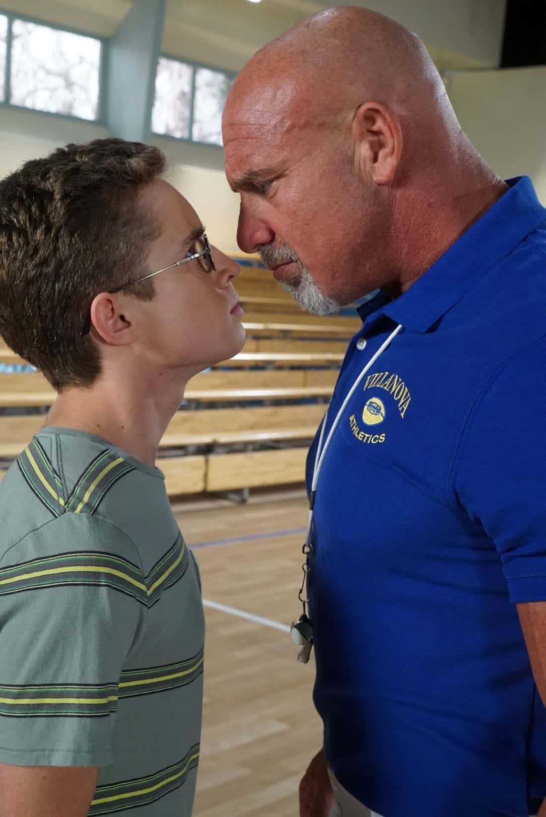 "THE GOLDBERGS- ""Goldberg On The Goldbergs"" - Beverly confronts Coach Mellor who reveals his strained relationship with his own brother Coach Nick, so she intervenes prompting Nick to face off with Rick. Adam and Barry join in, each one siding with one of the coaches. After a fight breaks out, Beverly points out to Adam and Barry this could be them as adults. Meanwhile, Geoff and Erica struggle with their relationship long distance, on ""The Goldbergs,"" WEDNESDAY, OCTOBER 11 (8:00-8:30 p.m. EDT), on The ABC Television Network. (ABC/Ron Tom) SEAN GIAMBRONE, BILL GOLDBERG"