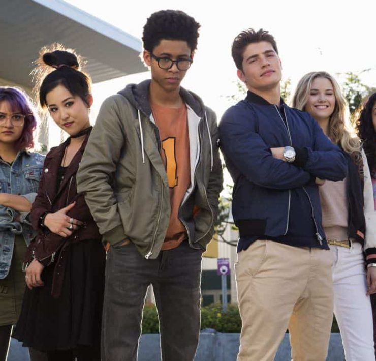 """MARVEL'S RUNAWAYS - """"Pilot"""" - Episode 101 - Every teenager thinks their parents are evil. What if you found out they actually were? MarvelÕs Runaways is the story of six diverse teenagers who can barely stand each other but who must unite against a common foe Ð their parents. The 10-episode series premieres Tuesday, November 21st. The series stars Rhenzy Feliz, Lyrica Okano, Virginia Gardner, Ariela Barer, Gregg Sulkin, Allegra Acosta, Annie Wersching, Ryan Sands, Angel Parker, Ever Carradine, James Marsters, Kevin Weisman, Brigid Brannah, James Yaegashi, Brittany Ishibashi, and Kip Pardue. From left: Gert Yorkes (Ariela Barer), Nico Minoru (Lyrica Okano), Alex Wilder (Rhenzy Feliz), Chase Stein (Gregg Sulkin), Karolina Dean (Virginia Gardner) and Molly Hernandez (Allegra Acosta), shown. (Photo by: Paul Sarkis/Hulu)"""