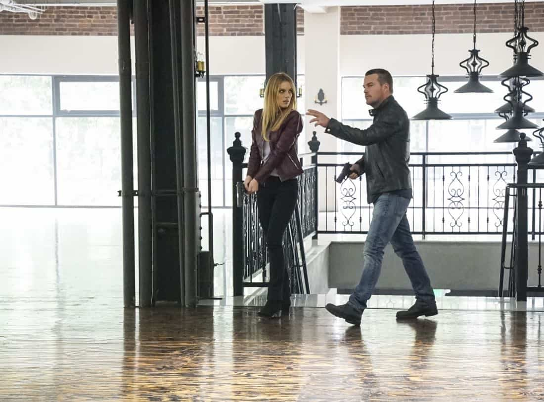 """Se Murio El Payaso"" -- Pictured: Bar Paly (Anastasia ""Anna"" Kolcheck) and Chris O'Donnell (Special Agent G. Callen). When the daughter of a notorious counterfeiter arrives in Los Angeles, Sam is sent undercover as a financier, while Callen partners with Anna (Bar Paley) to track the family's latest scheme, on NCIS: LOS ANGELES, Sunday, Oct. 8th (9:00 PM, ET/PT) on the CBS Television Network. Photo: Bill Inoshita/CBS ©2017 CBS Broadcasting, Inc. All Rights Reserved."
