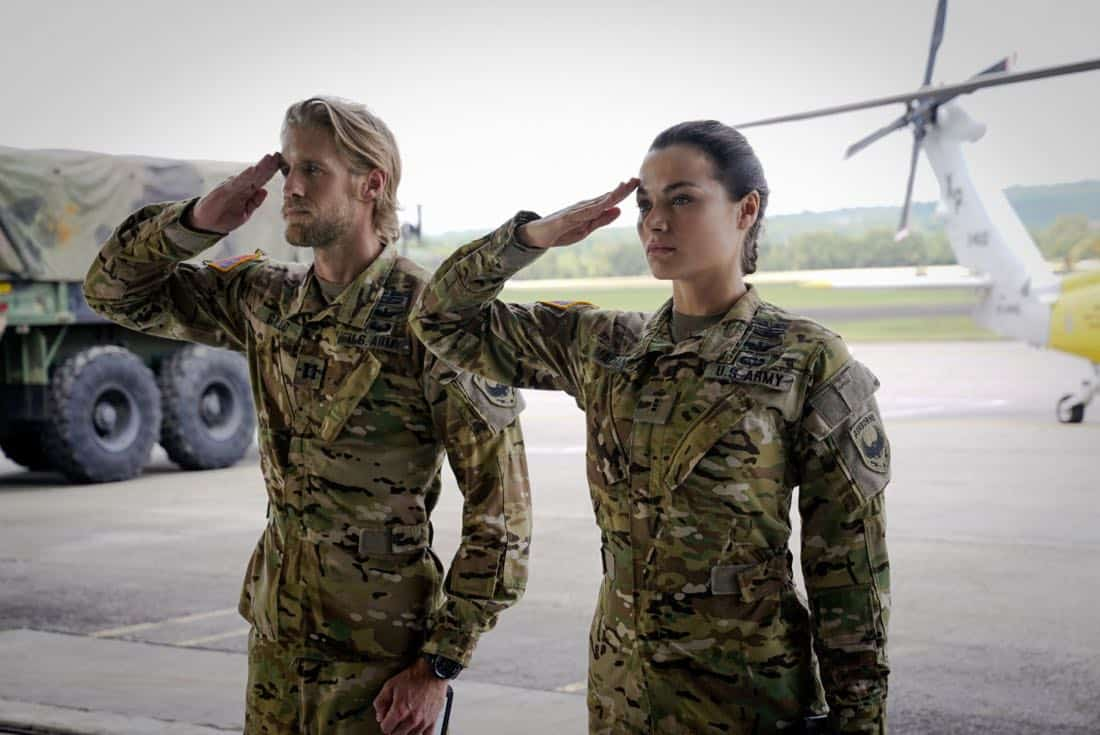 "Valor -- ""Esprit de Corps"" -- Image Number: VAL102a_0047.jpg -- Pictured (L-R): Christina Ochoa as Nora and Matt Barr as Gallo -- Photo: Quantrell Colbert/The CW -- © 2017 The CW Network, LLC. All Rights Reserved."