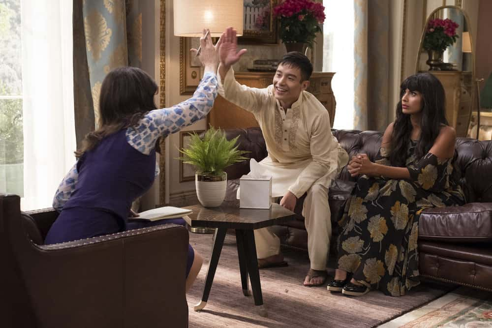 "THE GOOD PLACE -- ""The Trolley Problem"" Episode 206 -- Pictured: (l-r)  D'Arcy Carden as Janet, Manny Jacinto as Jianyu, Jameela Jamil as Tehani -- (Photo by: Colleen Hayes/NBC)"
