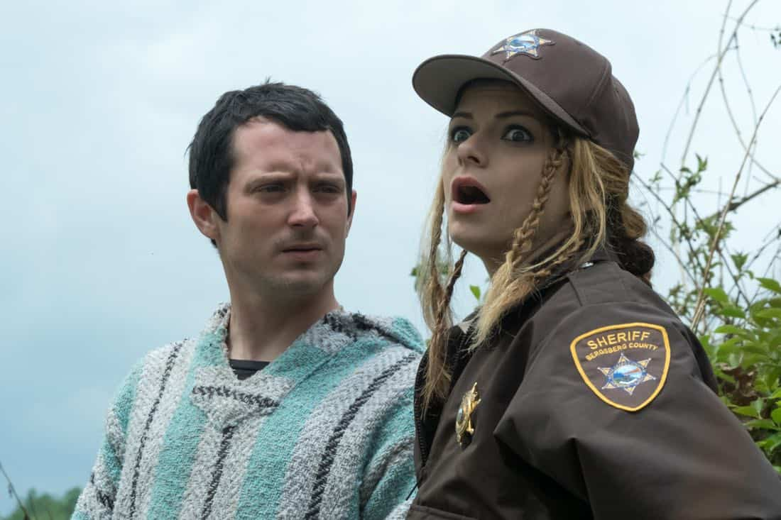 Todd Brotzman (Elijah Wood) and Deputy Tina (Izzie Steele)