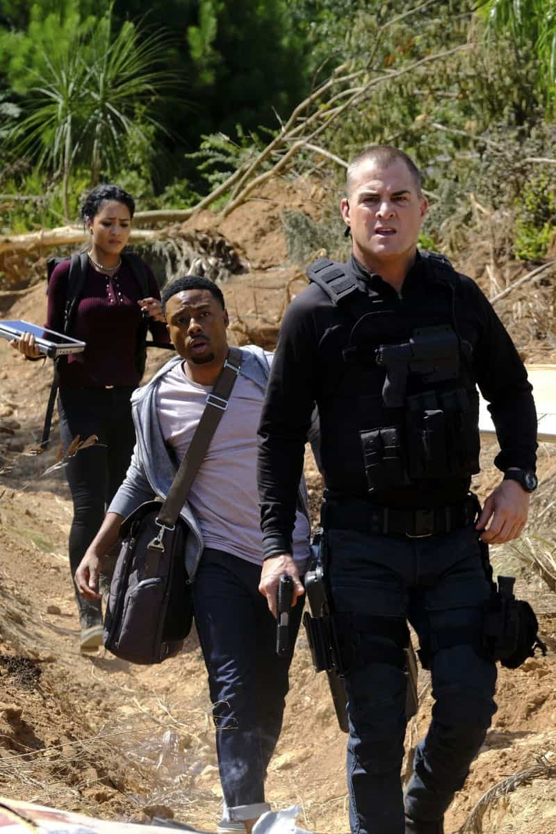 """Skull + Electromagnet"" -- The team is pulled away from their Halloween plans when they head into the dreaded Bermuda Triangle to retrieve the Vice President's son after his plane goes down with a mysterious prisoner on board, on MACGYVER, Friday, Oct. 27 (9:00-10:00 PM, ET/PT) on the CBS Television Network. Pictured: Tristin Mays, Justin Hires, George Eads  Photo: Guy D'Alema/CBS ©2017 CBS Broadcasting, Inc. All Rights Reserved"