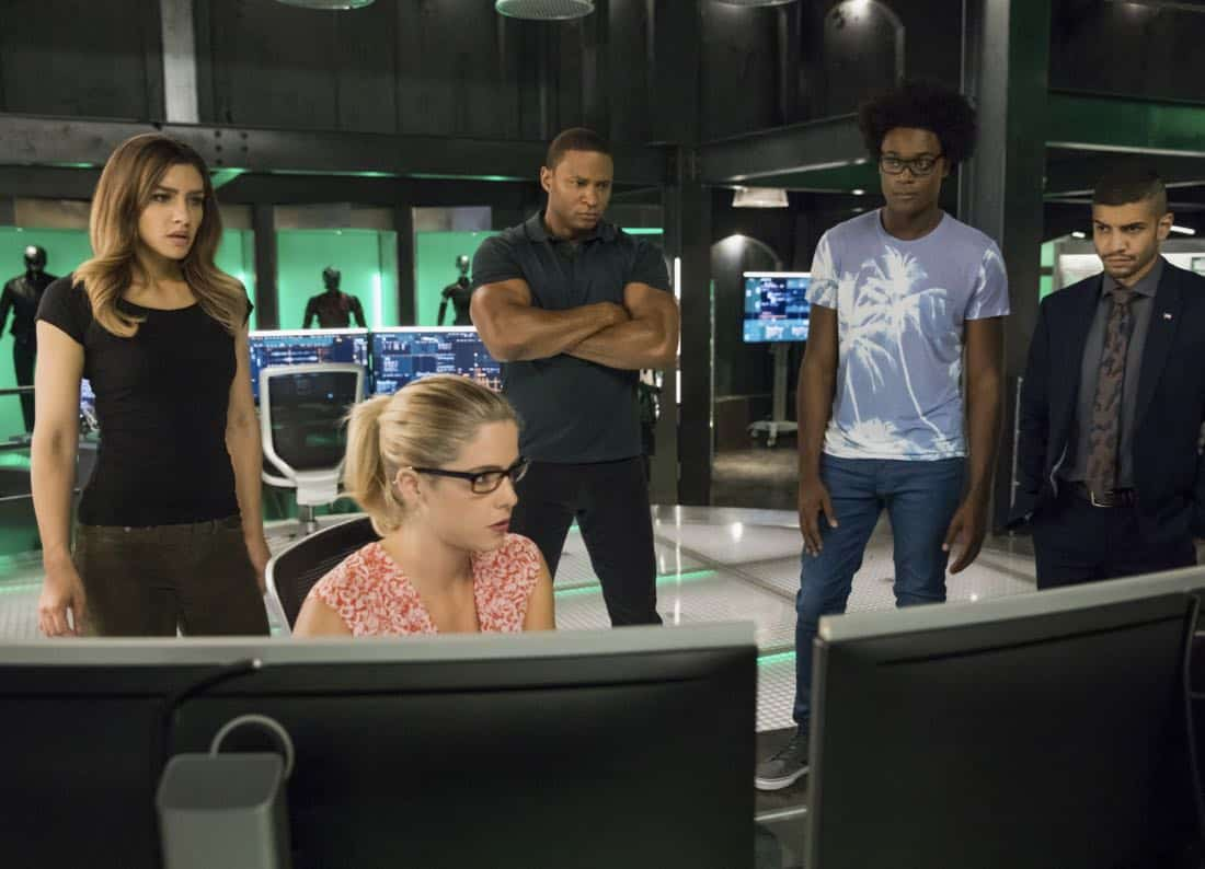 "Arrow -- ""Next of Kin"" -- Image AR603b_0382b.jpg -- Pictured (L-R): Juliana Harkavy as Dinah Drake/Black Canary, Emily Bett Rickards as Felicity Smoak, David Ramsey as John Diggle/Spartan, Echo Kellum as Curtis Holt/Mr.Terrific, and Rick Gonzalez as Rene Ramirez/Wild -- Photo: Jack Rowand/The CW -- © 2017 The CW Network, LLC. All Rights Reserved."