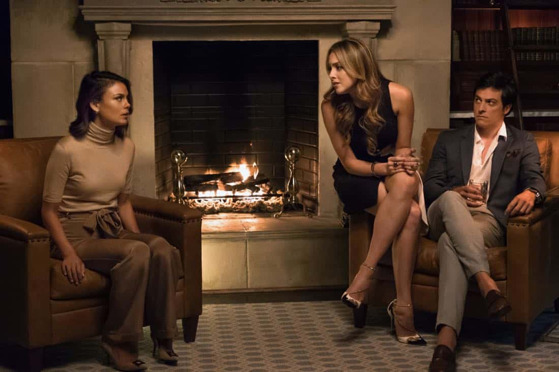 "Dynasty -- ""Spit It Out "" -- Image Number: DYN102a_0315.jpg -- Pictured (L-R): Nathalie Kelley as Cristal, Elizabeth Gillies as Fallon and James Mackay as Steven -- Photo: Mark Hill/The CW -- © 2017 The CW Network, LLC. All Rights Reserved."