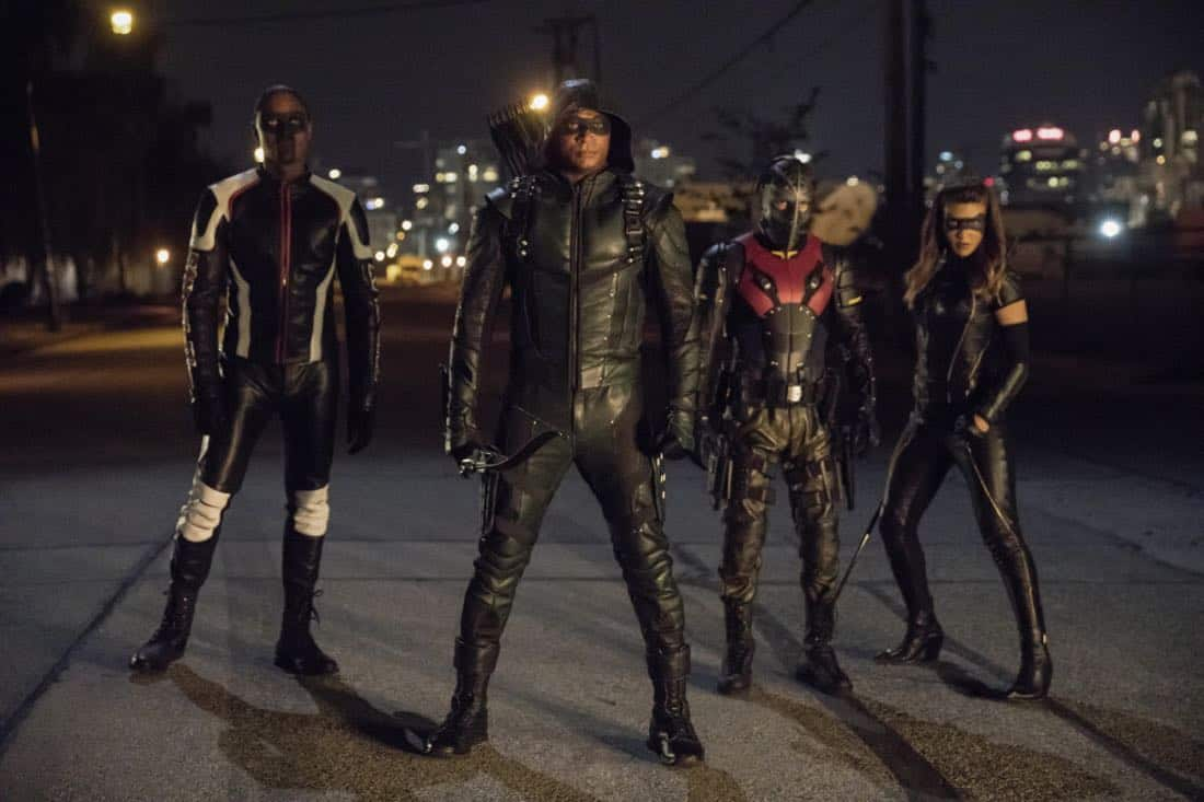 "Arrow -- ""Next of Kin"" -- Image AR603b_0437b --Pictured (L-R): Echo Kellum as Curtis Holt/Mr.Terrific, David Ramsey as Green Arrow, Rick Gonzalez as Rene Ramirez/Wild, and Juliana Harkavy as Dinah Drake/Black Canary -- Photo: Jack Rowand/The CW -- © 2017 The CW Network, LLC. All Rights Reserved."