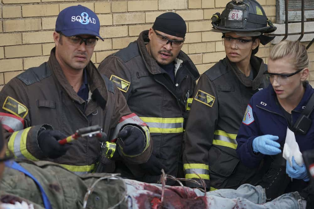 "CHICAGO FIRE -- ""Devil's Bargain"" Episode 605 -- Pictured: (l-r) Taylor Kinney as Kelly Severide, Joe Minoso as Joe Cruz, Miranda Rae Mayo as Stella Kidd, Kara Killmer as Sylvie Brett -- (Photo by: Elizabeth Morris/NBC)"
