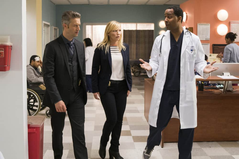 "LAW & ORDER: SPECIAL VICTIMS UNIT -- ""Complicated"" Episode 1905 -- Pictured: (l-r) Peter Scanavino as Dominick ""Sonny"" Carisi, Kelli Giddish as Detective Amanda Rollins, Lawrence Ballard as Dr. Leon Bailey -- (Photo by: Michael Parmelee/NBC)"