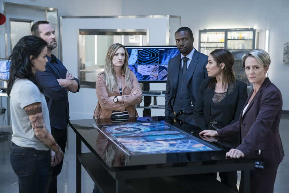 "BLINDSPOT -- ""Back to the Grind"" Episode 301 -- Pictured: (l-r) Jaimie Alexander as Jane Doe, Sullivan Stapleton as Kurt Weller, Ashley Johnson as Patterson, Rob Brown as Edgar Reade, Audrey Esparza as Tasha Zapata, Mary Stuart Masterson as Director Hirst -- (Photo by: Peter Kramer/NBC)"
