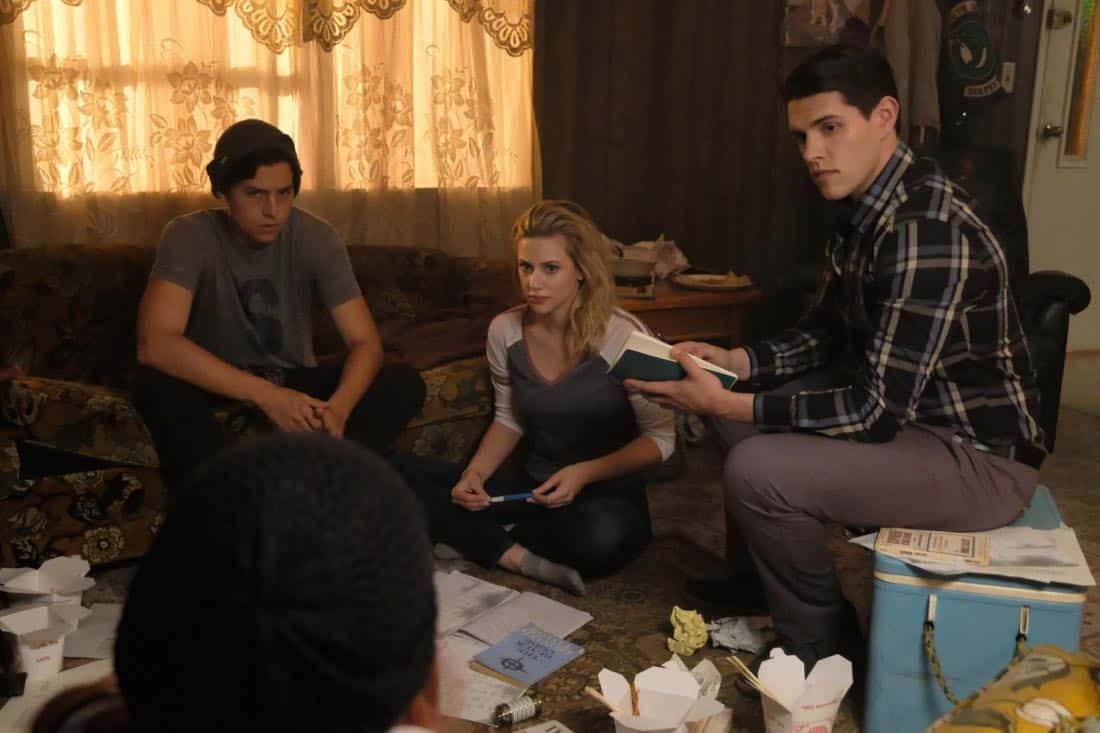 "Riverdale -- ""Chapter Seventeen: The Town that Dreaded Sundown"" -- Image Number: RVD204b_0270.jpg -- Pictured (L-R): Cole Sprouse as Jughead Jones, Lili Reinhart as Betty Cooper, and Casey Cott as Kevin Keller -- Photo: Bettina Strauss/The CW -- © 2017 The CW Network. All Rights Reserved"