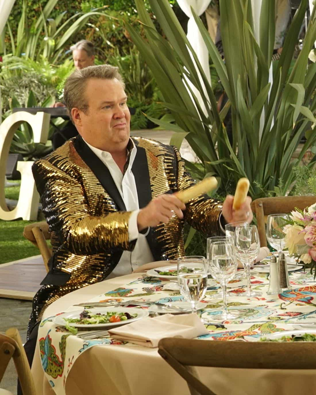 """MODERN FAMILY - """"Ten Years Later"""" - Claire is determined to make up for her less-than-joyful mood at Jay and Gloria's wedding by throwing their tenth-anniversary party. As part of the festivities, Phil is going to perform a magic trick featuring Gloria appearing out of thin air in her wedding dress; that is if Gloria can still get into it! - on """"Modern Family,"""" WEDNESDAY, NOV. 1 (9:00-9:31 p.m. EDT), on The ABC Television Network. (ABC/Ron Tom) ERIC STONESTREET"""