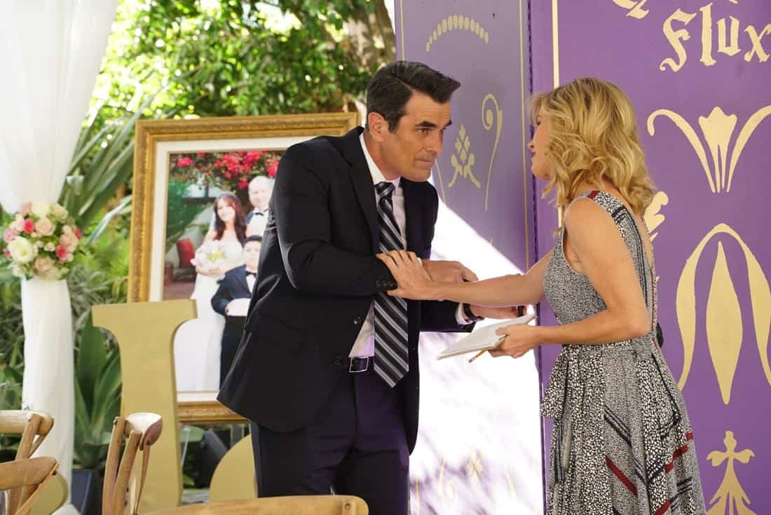"""MODERN FAMILY - """"Ten Years Later"""" - Claire is determined to make up for her less-than-joyful mood at Jay and Gloria's wedding by throwing their tenth-anniversary party. As part of the festivities, Phil is going to perform a magic trick featuring Gloria appearing out of thin air in her wedding dress; that is if Gloria can still get into it! - on """"Modern Family,"""" WEDNESDAY, NOV. 1 (9:00-9:31 p.m. EDT), on The ABC Television Network. (ABC/Ron Tom) TY BURRELL, JULIE BOWEN"""