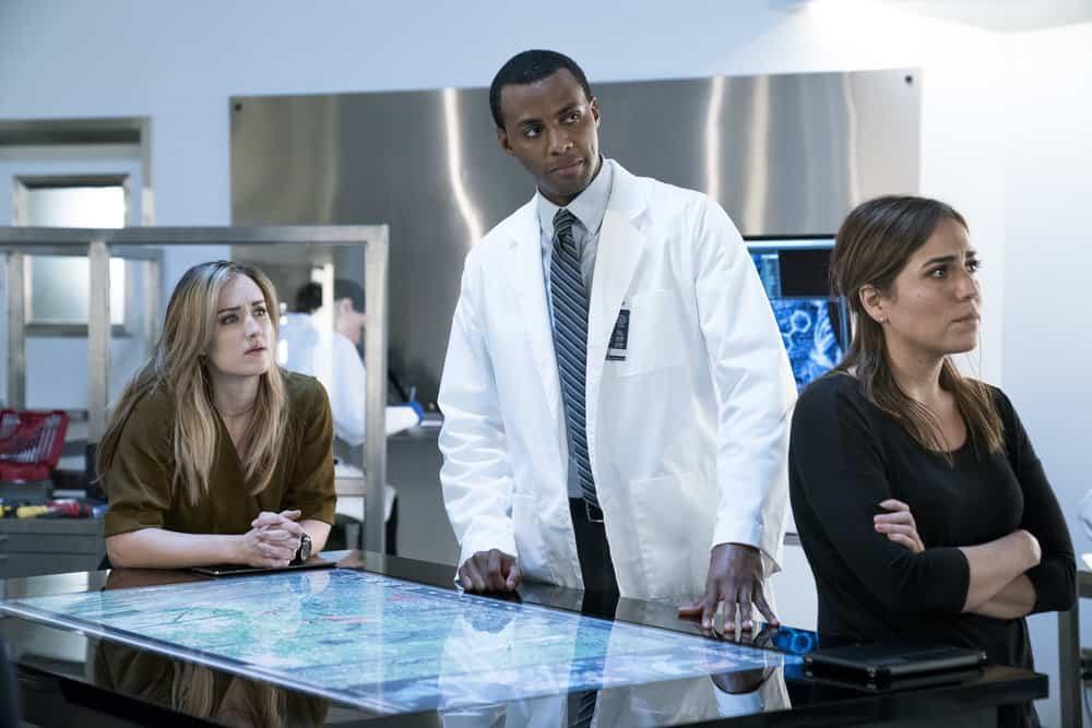 "BLINDSPOT -- ""Enemy Bag of Tricks"" Episode 302 -- Pictured: (l-r) Ashley Johnson as Patterson, Jordan Johnson-Hinds as Stuart, Audrey Esparza as Tasha Zapata -- (Photo by: David Geisbrecht/NBC/Warner Bros)"