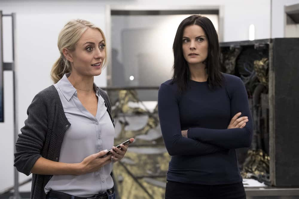 "BLINDSPOT -- ""Enemy Bag of Tricks"" Episode 302 -- Pictured: (l-r) Amy Rutberg as Marci, Jaimie Alexander as Jane Doe -- (Photo by: David Geisbrecht/NBC/Warner Bros)"