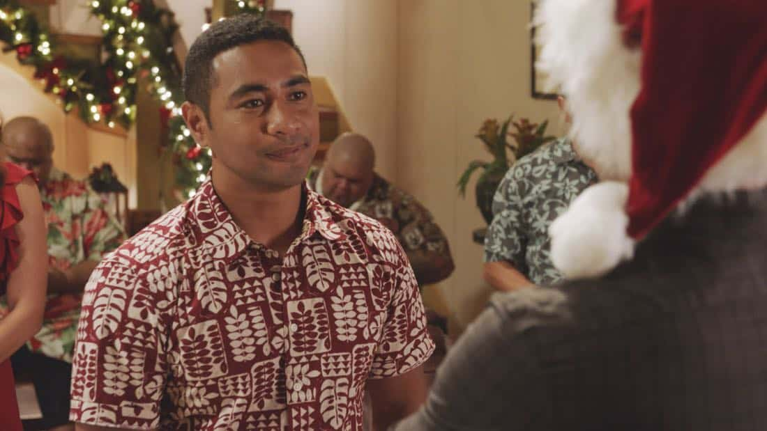 """Oni kalalea ke kū a ka lā'au loa""-- It's Christmas Eve and Danny tells Charlie a bedtime story about a recent Five-0 case involving bad Santas and a holiday miracle, on HAWAII FIVE-0, at a special time, Friday, Dec. 15 (10:00-11:00 PM, ET/PT) on the CBS Television Network. Real-life military veterans Jason Redman, Steven Jackel, Kathryn Taylor-Smith and J. Eddie Martinez guest star as veterans who help McGarrett with the case. Pictured left to right: Beulah Koale as Junior Reigns. Photo credit: Screengrab/©2017 CBS Broadcasting, Inc. All Rights Reserved.     (""Oni kalalea ke kū a ka lā'au loa"" is Hawaiian for ""A Tall Tree Stands Above the Others"")"