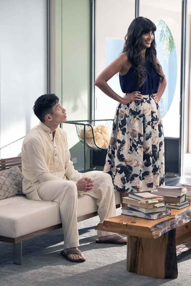 """THE GOOD PLACE -- """"Leap Into Faith"""" Episode 209 -- Pictured: (l-r) Manny Jacinto as Jianyu, Jameela Jamil as Tehani -- (Photo by: Colleen Hayes/NBC)"""