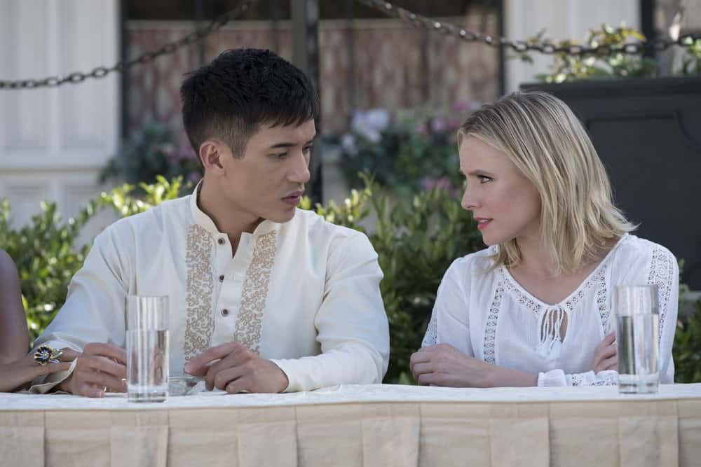 """THE GOOD PLACE -- """"Leap Into Faith"""" Episode 209 -- Pictured: (l-r) Manny Jacinto as Jianyu, Kristen Bell as Eleanor -- (Photo by: Colleen Hayes/NBC)"""