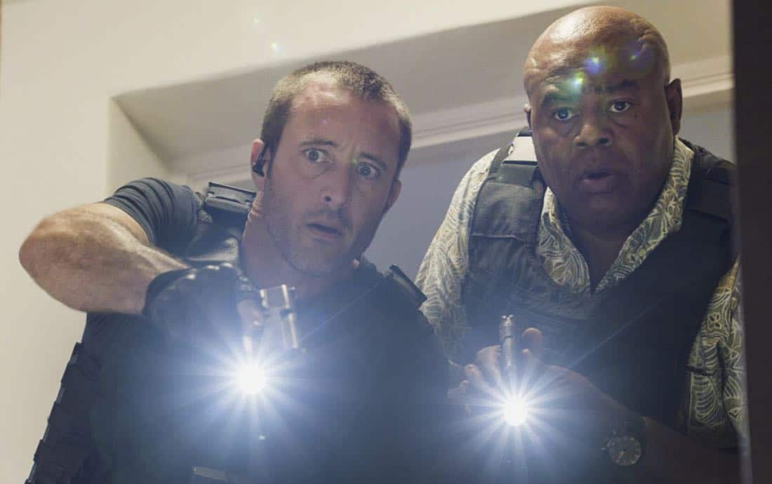 """""""Ka hopu nui 'ana""""-- When an FBI agent who was cracking down on organized crime is killed, McGarrett rounds up every gang-related criminal on the island to find the culprit. Also, McGarrett tasks Adam with forming a new division within Five-0 to take on organized crime, on HAWAII FIVE-0, Friday, Jan. 5 (9:00-10:00 PM, ET/PT) on the CBS Television Network. Pictured left to right: Alex O'Loughlin as Steve McGarrett and Chi McBride as Lou Grover. Photo credit: Screengrab/©2017 CBS Broadcasting, Inc. All Rights Reserved.   (""""Ka hopu nui 'ana"""" is Hawaiian for """"The Round Up"""")"""