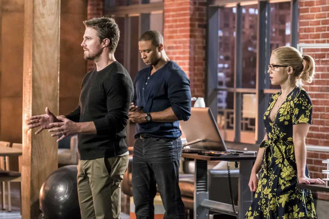 """Arrow -- """"Divided"""" -- Image Number: AR610b_0105.jpg -- Pictured (L-R): Stephen Amell as Oliver Queen/Green Arrow, David Ramsey as John Diggle/Spartan and Emily Bett Rickards as Felicity Smoak -- Photo: Daniel Power/The CW -- © 2018 The CW Network, LLC. All Rights Reserved."""