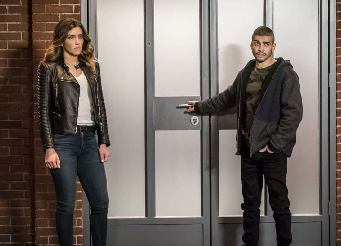 """Arrow -- """"Divided"""" -- Image Number: AR610b_0144.jpg -- Pictured (L-R): Juliana Harkavy as Dinah Drake/Black Canary and Rick Gonzalez as Rene Ramirez/Wild Dog -- Photo: Daniel Power/The CW -- © 2018 The CW Network, LLC. All Rights Reserved."""