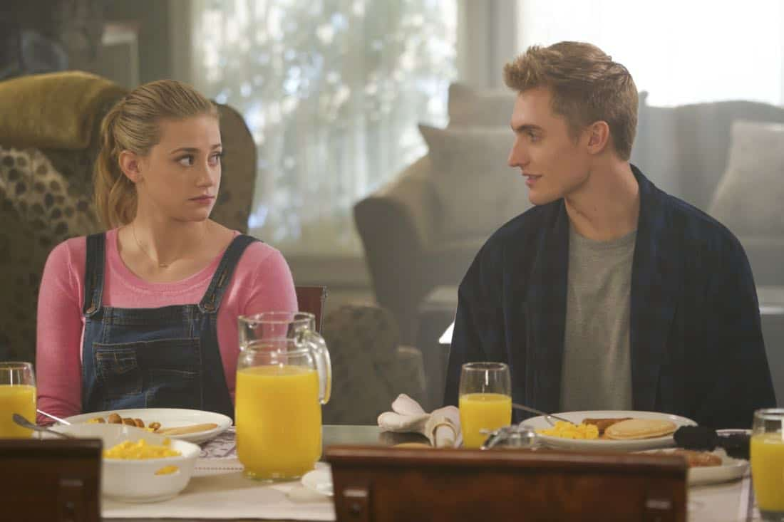 """Riverdale -- """"Chapter Twenty-Four: The Wrestler"""" -- Image Number: RVD211b_0188.jpg -- Pictured (L-R): Lili Reinhart as Betty and Hart Denton as Chic -- Photo: Shane Harvey/The CW -- © 2018 The CW Network, LLC. All rights reserved."""