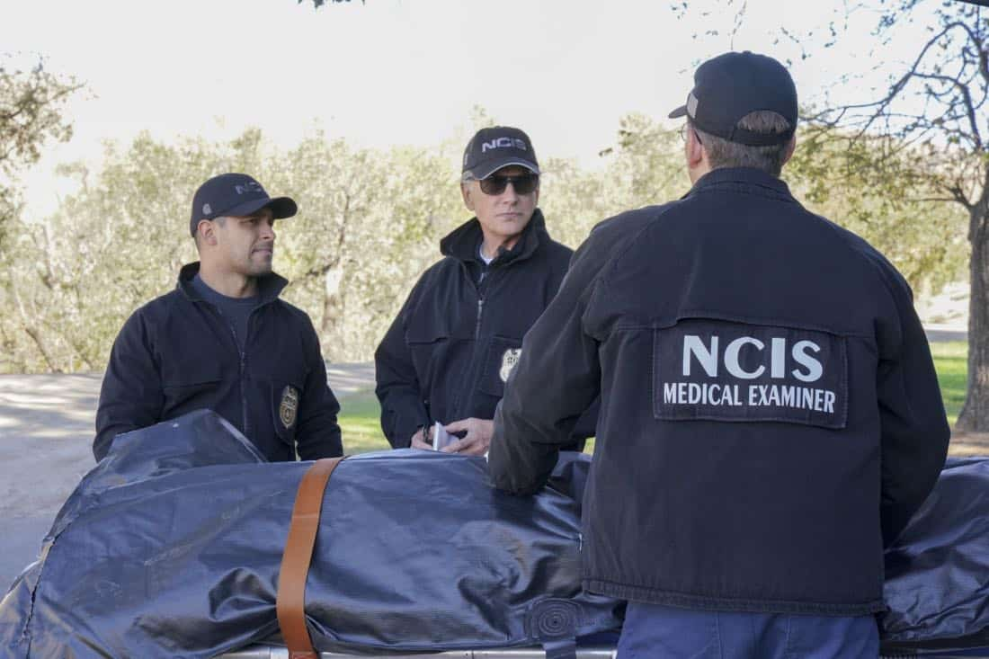 """Family Ties"" -- After McGee and Torres visit the home of a high schooler who witnessed a hit and run, her parents, Christopher (Jamie Kaler) and Julie Bell (Gabrielle Carteris), flee with their daughter, leaving NCIS in the lurch. Also, Vance's daughter is arrested for shoplifting, on NCIS, Tuesday, Jan. 23 (8:00-9:00 PM, ET/PT) on the CBS Television Network. Pictured: Wilmer Valderrama, Mark Harmon, Brian Dietzen. Photo: Bill Inoshita/CBS ©2017 CBS Broadcasting, Inc. All Rights Reserved"