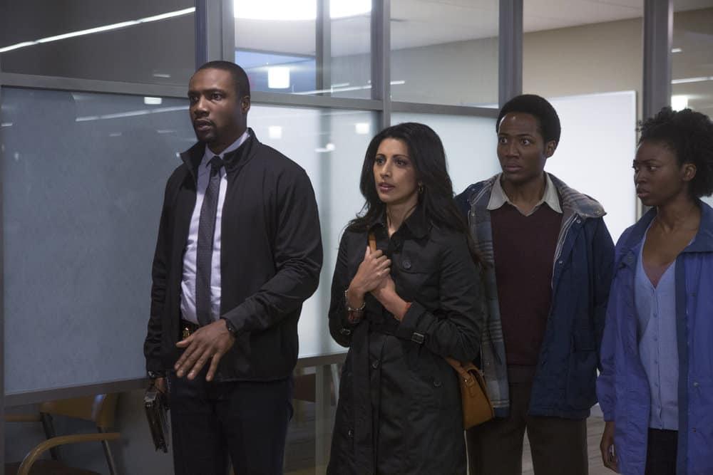 "BLINDSPOT -- ""Balance of Might"" Episode 310 -- Pictured: (l-r) Rob Brown as Edgar Reade, Reshma Shetty as Megan Butani, Hubert Point-Du Jour as Akol, Emma Claye as Winny -- (Photo by Eric Liebowitz/NBC/Warner Bros)"