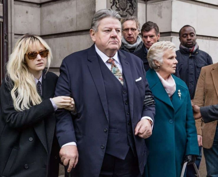 National Treasure follows Paul Finchley, an ageing, beloved comedian, a hero to TV audiences and peers alike, after he is arrested following an allegation of rape dating back to the 90s. The four-part drama follows the story from arrest through to verdict and focuses both on the investigation, and the effect of the case on Paul and his family; his wife of 40 years, Marie, and his troubled daughter, Dee. National Treasure is a story that goes behind the headlines to look at the human and emotional impact when a whole life is called into question. It explores memory, truth, age, doubt, and how well we really know ourselves and those close to us. From left, Dee Finchley (Andrea Riseborouch), Paul Finchley (Robbie Coltrane) and Marie Finchley (Julie Waters), shown. (Photo credit: Hulu