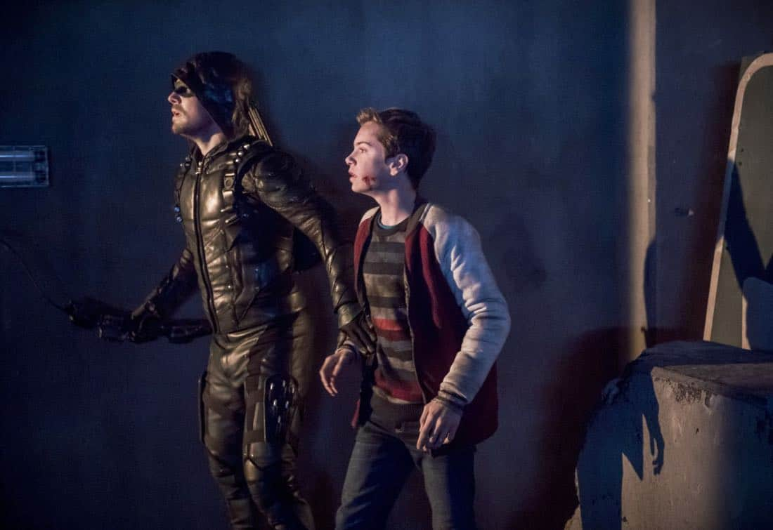"Arrow -- ""We Fall"" -- Image Number: AR611b_0085.jpg -- Pictured (L-R): Stephen Amell as Oliver Queen/Green Arrow and Jack Moore as William Clayton -- Photo: Diyah Pera/The CW -- © 2018 The CW Network, LLC. All Rights Reserved."