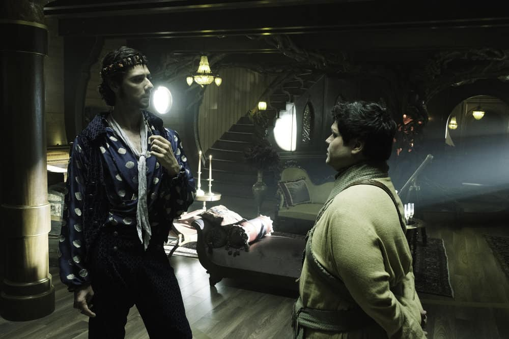 "THE MAGICIANS -- ""The Losses of Magic"" Episode 303 -- Pictured: (l-r) Hale Appleman as Eliot Waugh, Harvey Guillen as Benedict -- (Photo by: Eric Milner/Syfy)"